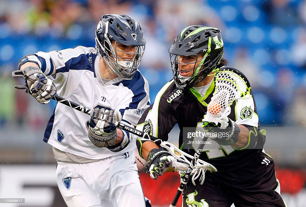 Max Seibald of the New York Lizards controls the ball against Matt Abbott of the Chesapeake Bayhawks during the first half of their Major League...