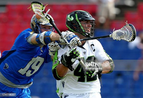 Max Seibald of the New York Lizards is hit from behind by Kevin Drew of the Charlotte Hounds at American Legion Memorial Stadium on July 20 2013 in...