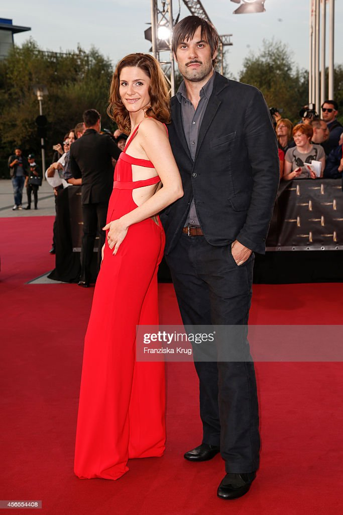 Max Simonischek and guest attend the red carpet of the Deutscher Fernsehpreis 2014 on October 02, 2014 in Cologne, Germany.