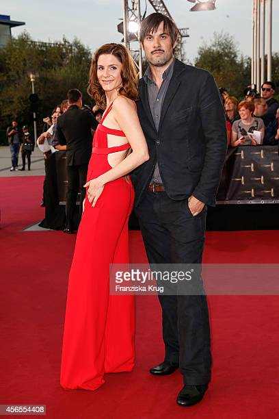 Max Simonischek and guest attend the red carpet of the Deutscher Fernsehpreis 2014 on October 02 2014 in Cologne Germany