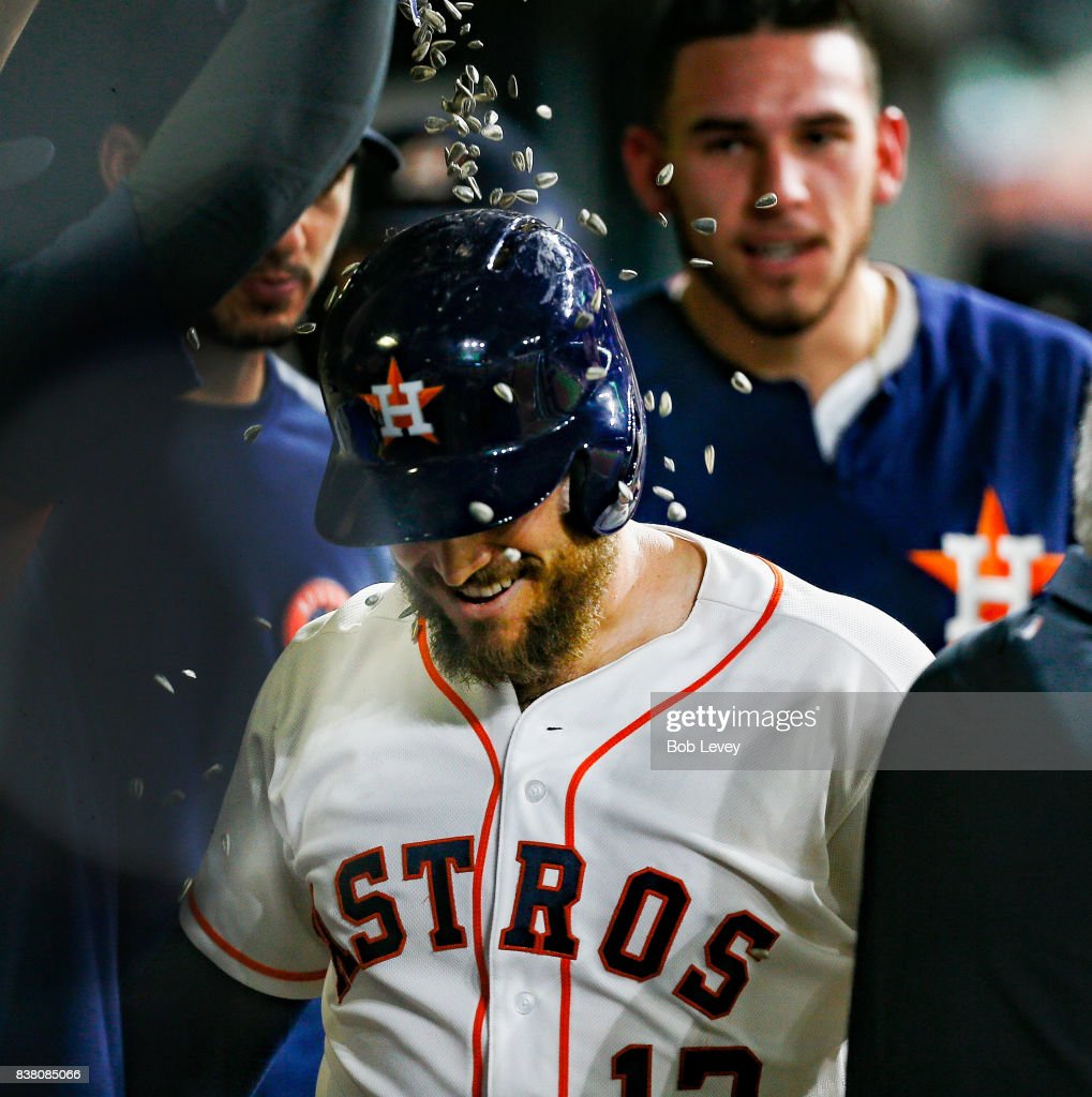Max Stassi #12 of the Houston Astros is showered with sunflower seeds after a home run in the eighth inning against the Washington Nationals at Minute Maid Park on August 23, 2017 in Houston, Texas.