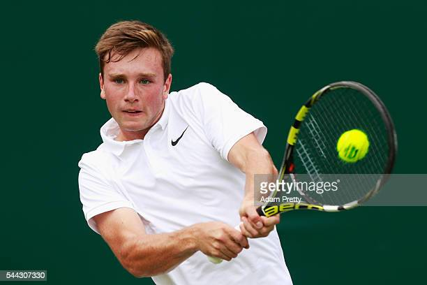 Max Stewart of Great Britain plays a backhand during the Boy's singles first round match against Daniel Altmaier of Germany on Middle Sunday of the...