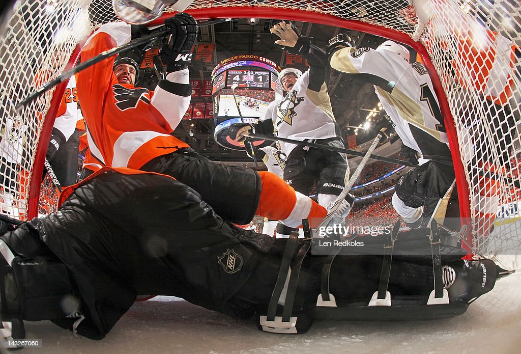 Max Talbot #27 and <a gi-track='captionPersonalityLinkClicked' href=/galleries/search?phrase=Ilya+Bryzgalov&family=editorial&specificpeople=2285430 ng-click='$event.stopPropagation()'>Ilya Bryzgalov</a> #30 of the Philadelphia Flyers are interfered with in the crease by <a gi-track='captionPersonalityLinkClicked' href=/galleries/search?phrase=Chris+Kunitz&family=editorial&specificpeople=604159 ng-click='$event.stopPropagation()'>Chris Kunitz</a> #14 and <a gi-track='captionPersonalityLinkClicked' href=/galleries/search?phrase=James+Neal&family=editorial&specificpeople=1487991 ng-click='$event.stopPropagation()'>James Neal</a> #18 of the Pittsburgh Penguins, resulting in a disallowed goal in the third period in Game Six of the Eastern Conference Quarterfinals during the 2012 NHL Stanley Cup Playoffs on April 22, 2012 at the Wells Fargo Center in Philadelphia, Pennsylvania. The Flyers defeated the Penguins 5-1 to win this series in six games.