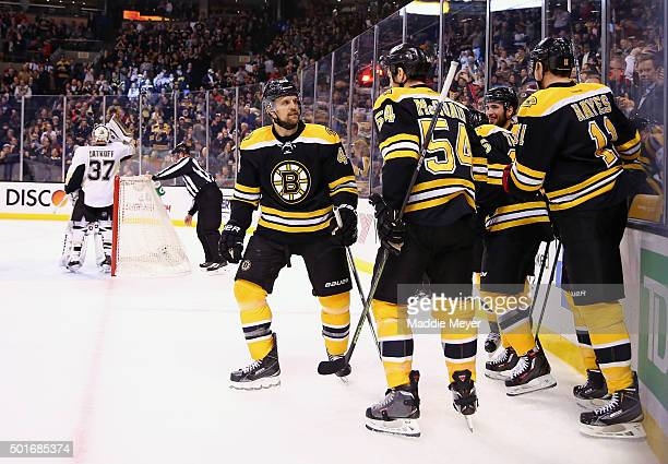 Max Talbot of the Boston Bruins is congratulated by Dennis Seidenberg Adam McQuaid and Jimmy Hayes after scoring a goal against the Pittsburgh...