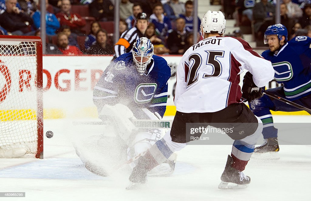 Max Talbot #25 of the Colorado Avalanche watches teammate Tyson Barrie's (not picutred) shot go past goalie <a gi-track='captionPersonalityLinkClicked' href=/galleries/search?phrase=Jacob+Markstrom&family=editorial&specificpeople=5370948 ng-click='$event.stopPropagation()'>Jacob Markstrom</a> #35 of the Vancouver Canucks for a goal during the third period in NHL action on April 10, 2014 at Rogers Arena in Vancouver, British Columbia, Canada.