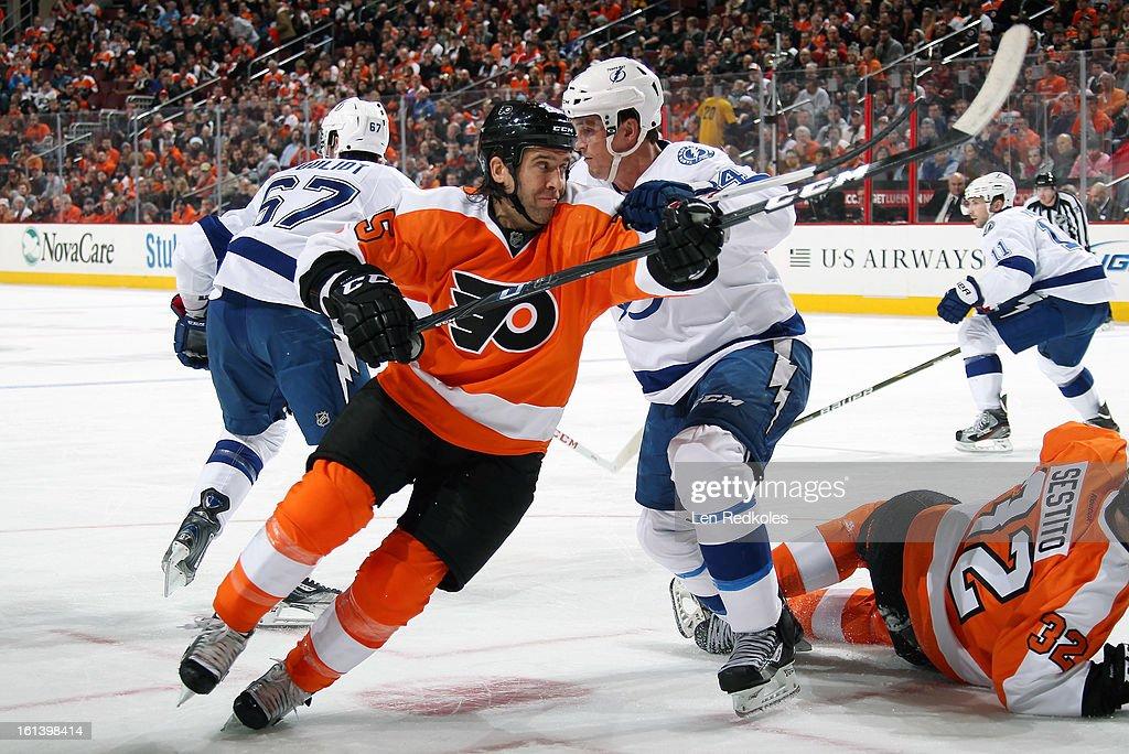 Max Talbot #25 of the Philadelphia Flyers skates past Vincent LeCavalier #4 of the Tampa Bay Lightning on February 5, 2013 at the Wells Fargo Center in Philadelphia, Pennsylvania.