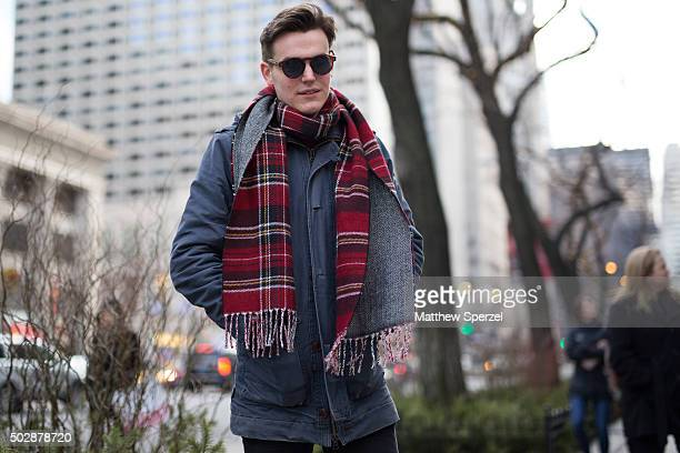 Max van Klink is seen on Michigan Avenue wearing a blue denim Chasin' coat red striped Urban Outfitters scarf Kimono glasses black denim Wow Hundred...
