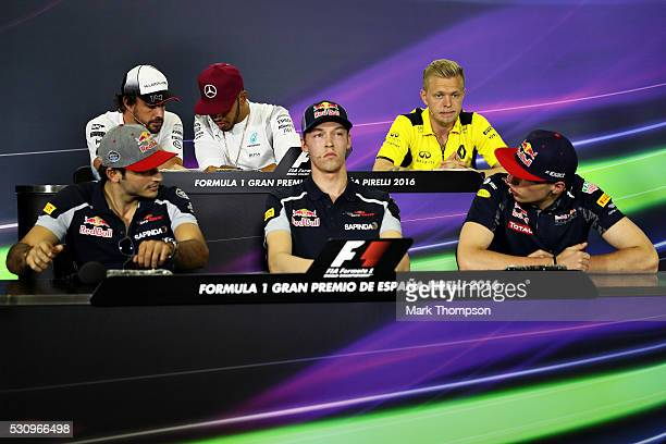 Max Verstappen of Netherlands and Red Bull Racing and Carlos Sainz of Spain and Scuderia Toro Rosso talk next to Daniil Kvyat of Russia and Scuderia...