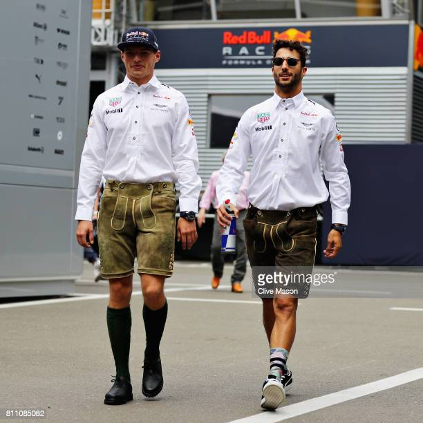 Max Verstappen of Netherlands and Red Bull Racing and Daniel Ricciardo of Australia and Red Bull Racing wear lederhosen on their way to the drivers...