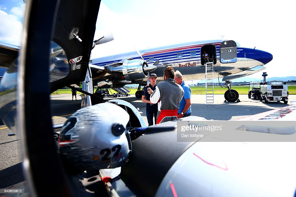 <a gi-track='captionPersonalityLinkClicked' href=/galleries/search?phrase=Max+Verstappen&family=editorial&specificpeople=12813205 ng-click='$event.stopPropagation()'>Max Verstappen</a> of Netherlands and Red Bull Racing and Red Bull Racing Team Consultant Dr <a gi-track='captionPersonalityLinkClicked' href=/galleries/search?phrase=Helmut+Marko&family=editorial&specificpeople=1692282 ng-click='$event.stopPropagation()'>Helmut Marko</a> speak with Red Bull Air Race pilot <a gi-track='captionPersonalityLinkClicked' href=/galleries/search?phrase=Hannes+Arch&family=editorial&specificpeople=4511432 ng-click='$event.stopPropagation()'>Hannes Arch</a> before boarding the Red Bull Douglas DC-6B during a Red Bull Racing media flight to Hangar 7 on June 29, 2016 in Salzburg, Austria.