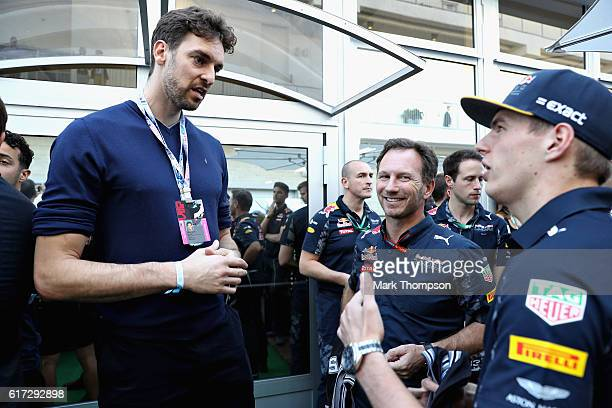 Max Verstappen of Netherlands and Red Bull Racing and Red Bull Racing Team Principal Christian Horner talks with San Antonio Spurs basketball player...