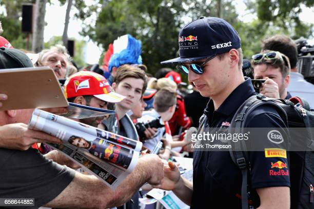 Max Verstappen of Netherlands and Red Bull Racing arrives at the circuit and signs autographs for fans during previews to the Australian Formula One...