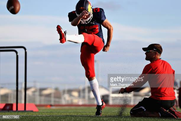 Max Verstappen of Netherlands and Red Bull Racing at a training session with the Del Valle Cardinals High School Football Team during previews ahead...