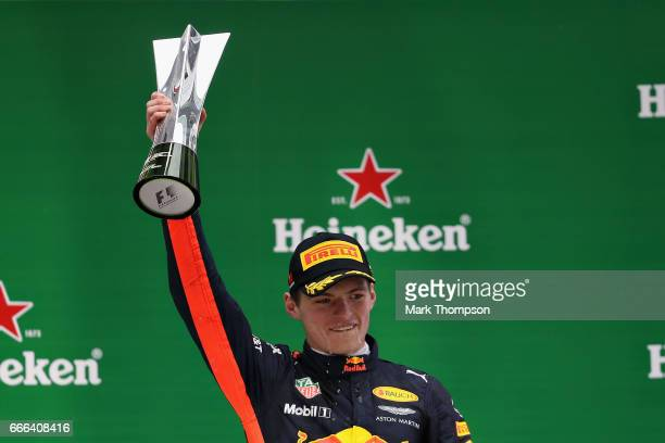 Max Verstappen of Netherlands and Red Bull Racing celebrates his third place finish on the podium during the Formula One Grand Prix of China at...