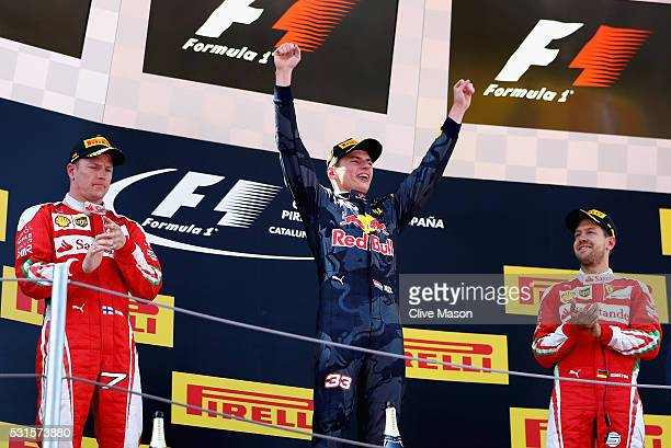 Max Verstappen of Netherlands and Red Bull Racing celebrates his first win on the podium with Kimi Raikkonen of Finland and Ferrari and Sebastian...