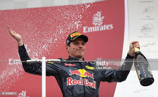 Max Verstappen of Netherlands and Red Bull Racing celebrates on the podium after finishing second during the Formula One Grand Prix of Japan at...