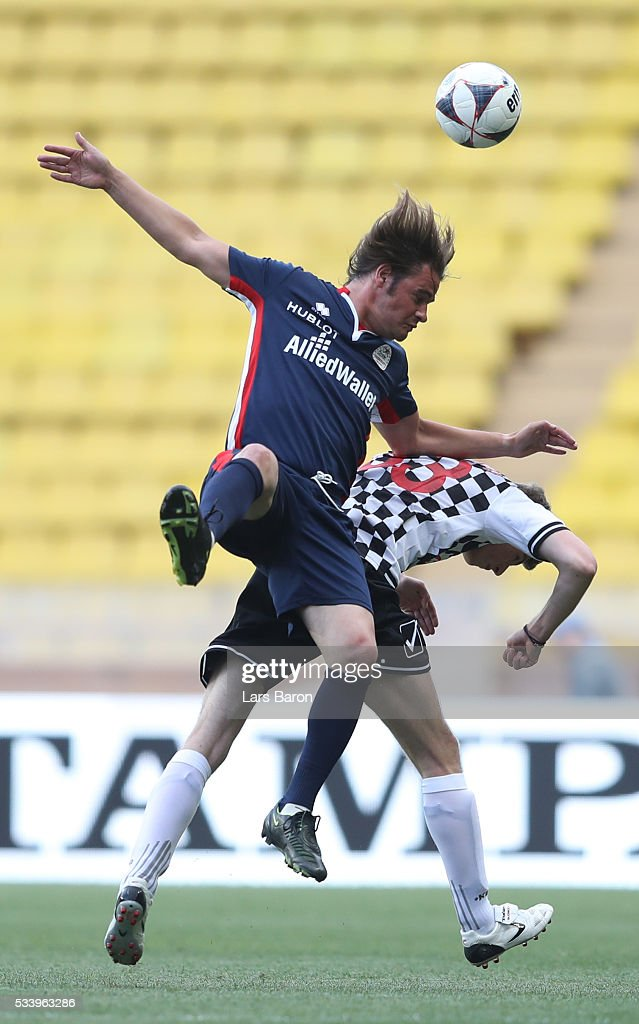 Max Verstappen of Netherlands and Red Bull Racing challenged by during the 24th World Stars football match at Stade Louis II, Monaco before the Monaco Formula One Grand Prix at Circuit de Monaco on May 24, 2016 in Monte-Carlo, Monaco.