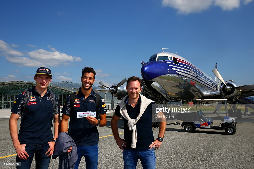 <a gi-track='captionPersonalityLinkClicked' href=/galleries/search?phrase=Max+Verstappen&family=editorial&specificpeople=12813205 ng-click='$event.stopPropagation()'>Max Verstappen</a> of Netherlands and Red Bull Racing, <a gi-track='captionPersonalityLinkClicked' href=/galleries/search?phrase=Daniel+Ricciardo&family=editorial&specificpeople=6547569 ng-click='$event.stopPropagation()'>Daniel Ricciardo</a> of Australia and Red Bull Racing and Red Bull Racing Team Principal <a gi-track='captionPersonalityLinkClicked' href=/galleries/search?phrase=Christian+Horner&family=editorial&specificpeople=228706 ng-click='$event.stopPropagation()'>Christian Horner</a> pose before boarding the Red Bull Douglas DC-6B during a Red Bull Racing media flight to Hangar 7 on June 29, 2016 in Salzburg, Austria.