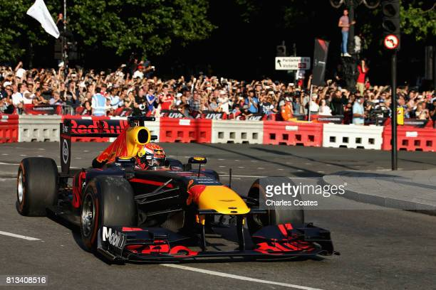 Max Verstappen of Netherlands and Red Bull Racing drives the Red Bull Racing RB7 during F1 Live London at Trafalgar Square on July 12 2017 in London...