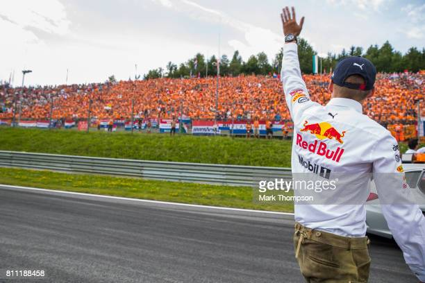 Max Verstappen of Netherlands and Red Bull Racing engages with the fans on the drivers parade before the Formula One Grand Prix of Austria at Red...