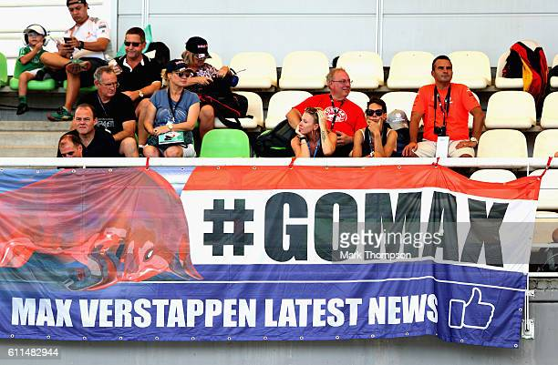 Max Verstappen of Netherlands and Red Bull Racing fans watch the action in a grandstand during practice for the Malaysia Formula One Grand Prix at...