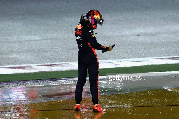 Max Verstappen of Netherlands and Red Bull Racing looks on after retiring from the Formula One Grand Prix of Singapore at Marina Bay Street Circuit...