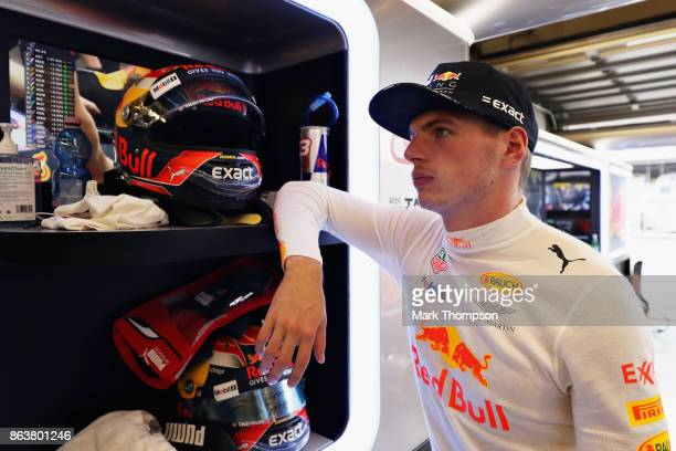 Max Verstappen of Netherlands and Red Bull Racing looks on in the garage during practice for the United States Formula One Grand Prix at Circuit of...
