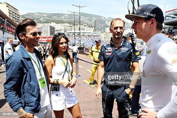 Max Verstappen of Netherlands and Red Bull Racing meets Louis Tomlinson singer and his girlfriend Danielle Campbell in the Pitlane before qualifying...