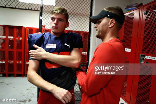Max Verstappen of Netherlands and Red Bull Racing prepares for a training session with the Del Valle Cardinals High School Football Team during...