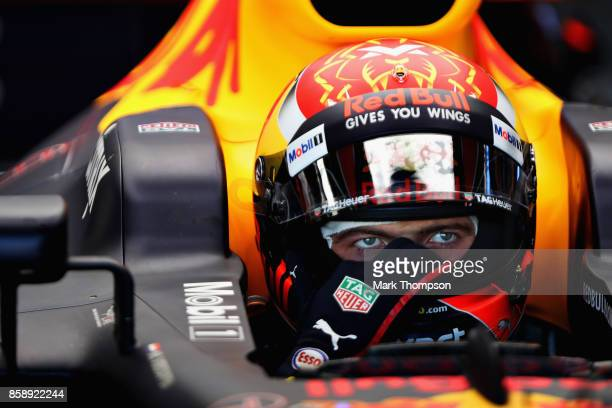 Max Verstappen of Netherlands and Red Bull Racing prepares to drive in the garage before the Formula One Grand Prix of Japan at Suzuka Circuit on...
