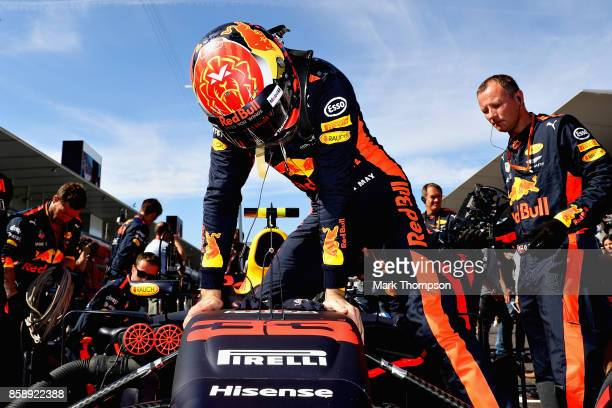 Max Verstappen of Netherlands and Red Bull Racing prepares to drive on the grid before the Formula One Grand Prix of Japan at Suzuka Circuit on...