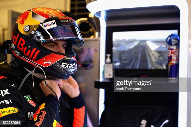 Max Verstappen of Netherlands and Red Bull Racing prepares to drive in the garage before the Abu Dhabi Formula One Grand Prix at Yas Marina Circuit...
