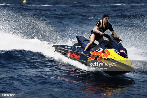 Max Verstappen of Netherlands and Red Bull Racing rides a jet ski in Monaco harbour during previews to the Monaco Formula One Grand Prix at Circuit...