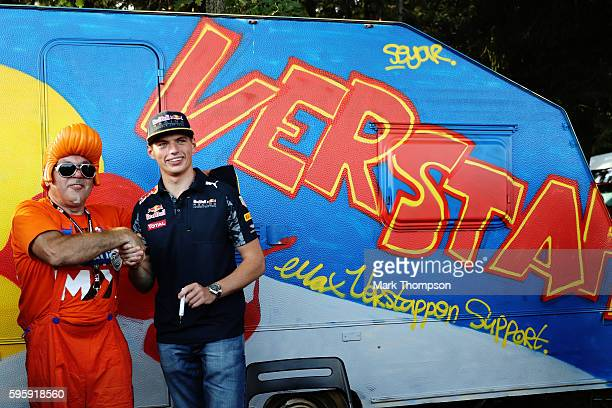 Max Verstappen of Netherlands and Red Bull Racing shakes hands with a fan on a campsite after practice for the Formula One Grand Prix of Belgium at...