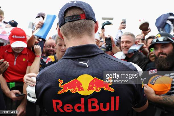 Max Verstappen of Netherlands and Red Bull Racing signs autographs for fans between practice for the United States Formula One Grand Prix at Circuit...