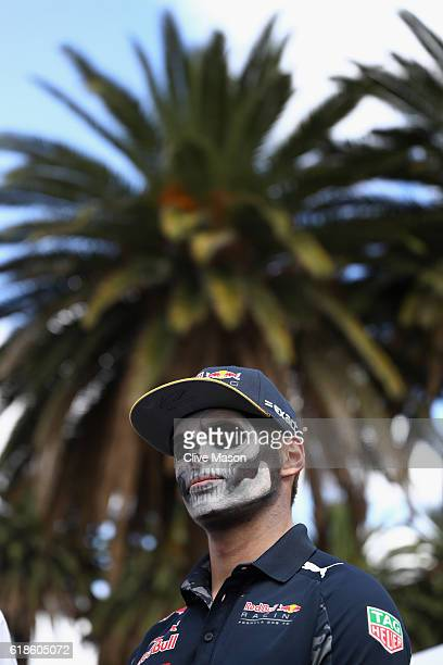 Max Verstappen of Netherlands and Red Bull Racing stands in the Paddock with full Dia de Muertos face paint during previews to the Formula One Grand...
