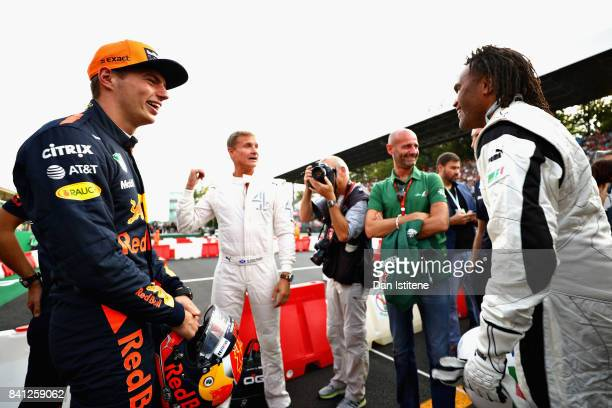 Max Verstappen of Netherlands and Red Bull Racing talks with David Coulthard and Christian Karembeu at a karting event during previews for the...