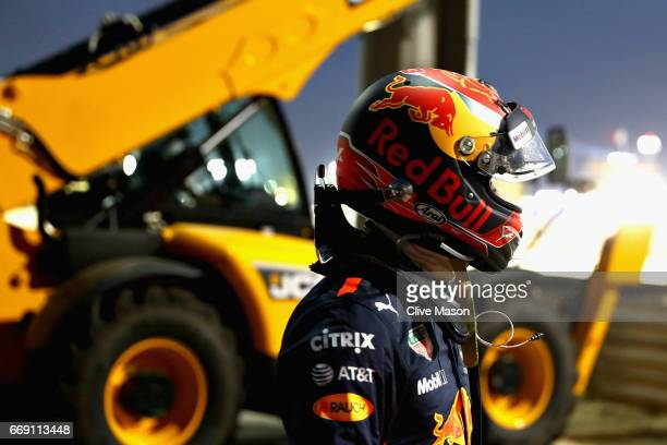 Max Verstappen of Netherlands and Red Bull Racing walks away after crashing into a barrier during the Bahrain Formula One Grand Prix at Bahrain...