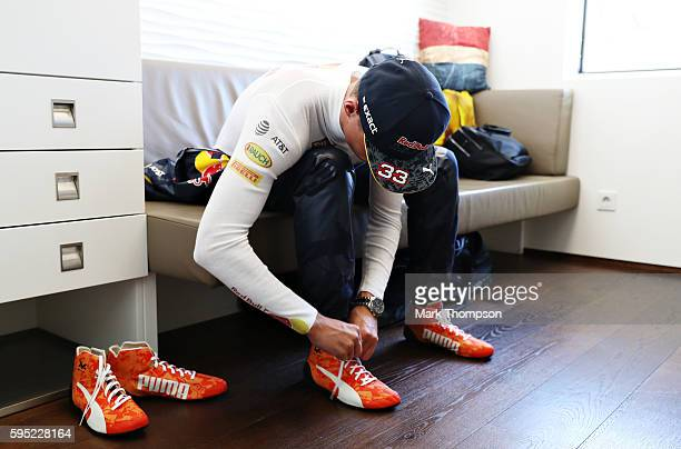 Max Verstappen of Netherlands and Red Bull Racing with his new orange racing boots during previews ahead of the Formula One Grand Prix of Belgium at...
