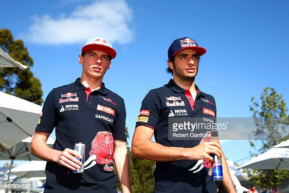 Max Verstappen of Netherlands and Scuderia Toro Rosso and Carlos Sainz of Spain and Scuderia Toro Rosso walk through the paddock during previews to...