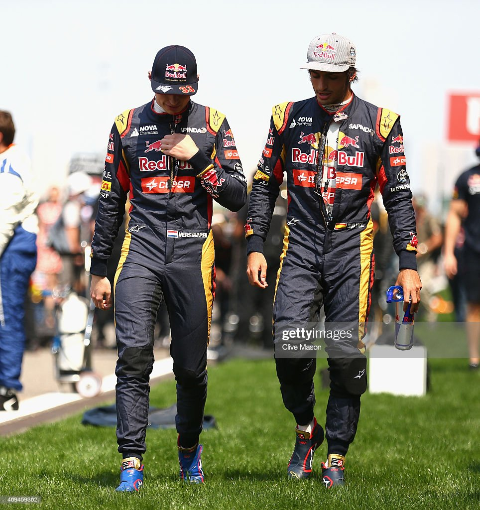 Max Verstappen of Netherlands and Scuderia Toro Rosso and Carlos Sainz of Spain and Scuderia Toro Rosso walk cross the paddock prior to the Formula...