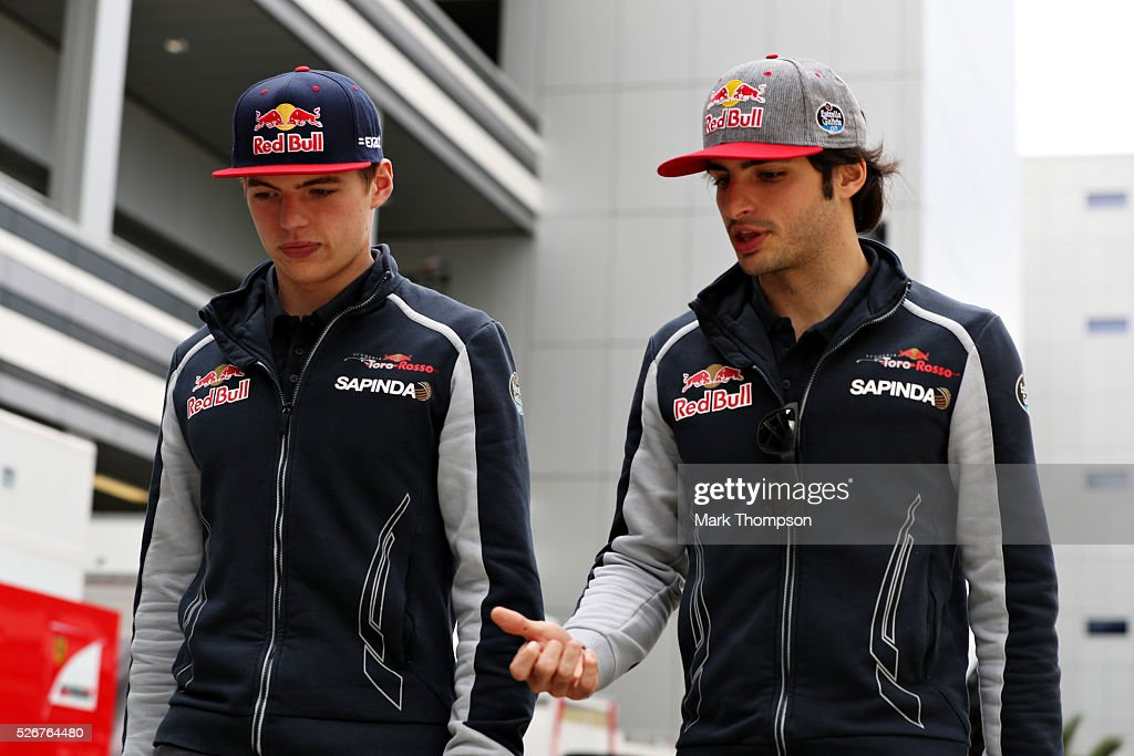 Max Verstappen of Netherlands and Scuderia Toro Rosso and Carlos Sainz of Spain and Scuderia Toro Rosso talk in the Paddock ahead of the Formula One Grand Prix of Russia at Sochi Autodrom on May 1, 2016 in Sochi, Russia.