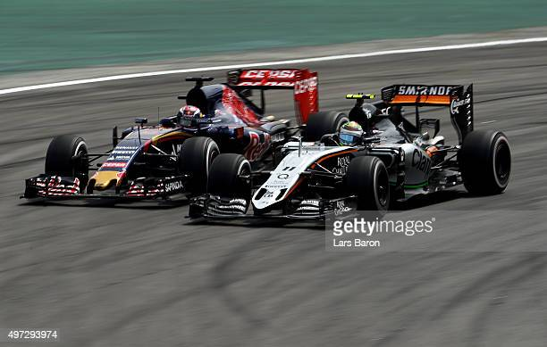 Max Verstappen of Netherlands and Scuderia Toro Rosso drives next to Sergio Perez of Mexico and Force India during the Formula One Grand Prix of...