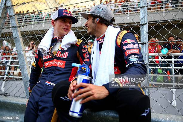 Max Verstappen of Netherlands and Scuderia Toro Rosso speaks with Carlos Sainz of Spain and Scuderia Toro Rosso on the grid before the Malaysia...