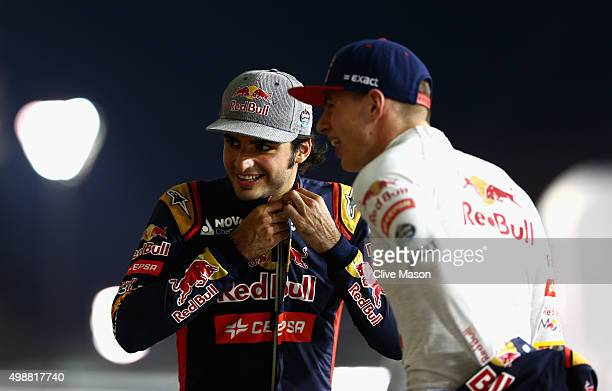 Max Verstappen of Netherlands and Scuderia Toro Rosso speaks with Carlos Sainz of Spain and Scuderia Toro Rosso as they wait in the pit lane for a...