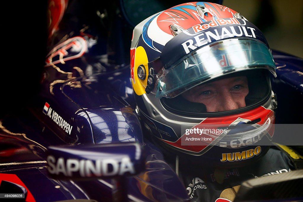 Max Verstappen of Netherlands and Scuderia Toro Rosso's father Jos Verstappen sits in his car in the garage after qualifying was suspended due to bad weather for the United States Formula One Grand Prix at Circuit of The Americas on October 24, 2015 in Austin, United States.