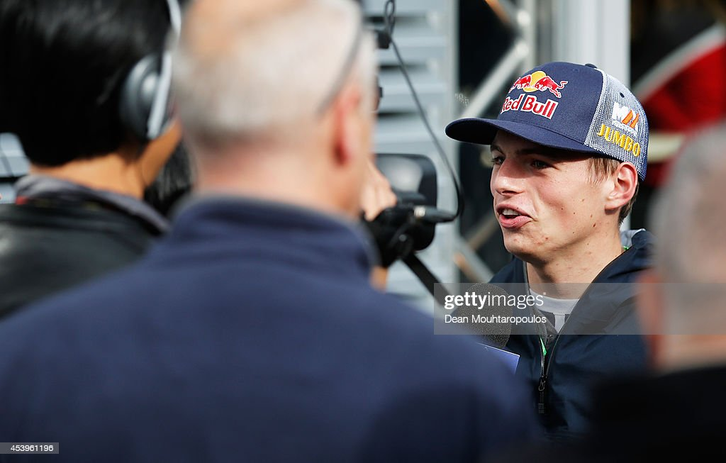 Max Verstappen of Netherlands, who will drive for Scuderia Toro Rosso next season, speaks with members of the media in the paddock during practice ahead of the Belgian Grand Prix at Circuit de Spa-Francorchamps on August 22, 2014 in Spa, Belgium.