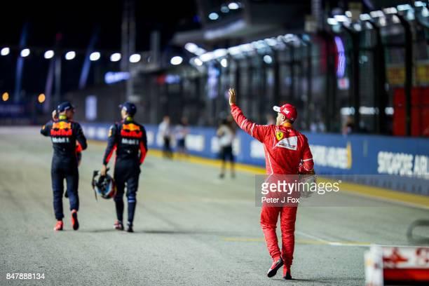 Max Verstappen of Red Bull Racing and The Netherlands Daniel Ricciardo of Australia and Red Bull Racing Sebastian Vettel of Ferrari and Germany...
