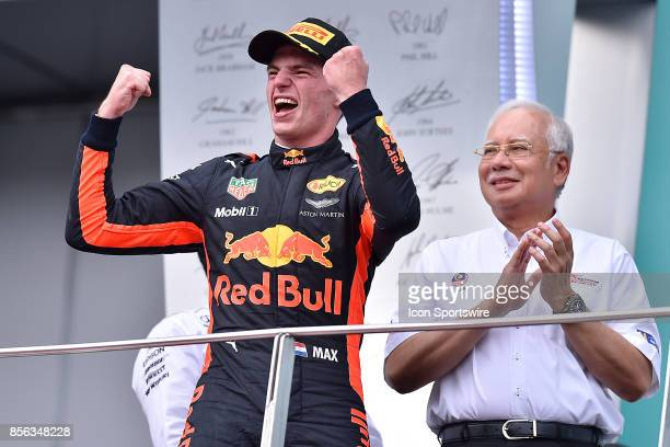 Max Verstappen of Red Bull Racing celebrate on the podium after winning the race of the Formula 1 Petronas Malaysia Grand Prix held at Sepang...