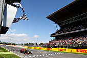 Max Verstappen of the Netherlands driving the Red Bull Racing Red BullTAG Heuer RB12 TAG Heuer takes the chequered flag for his first F1 win during...